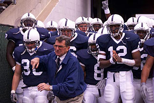 Coach Paterno leads Penn State out of the tunnel.